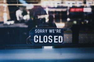Business with closed sign in window